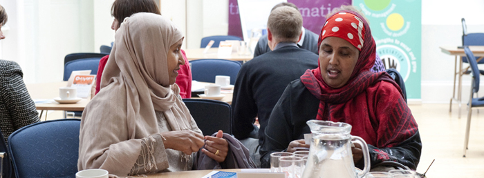 Two women talking. Community engagement and organisational development from appreciative inquiry practitioners Appreciating People; Liverpool, North West and UK, 0151 427 1146